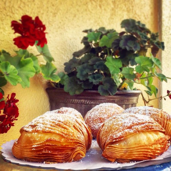 A shell-shaped, multi-layered pastry, filled with Crema Pasticciera