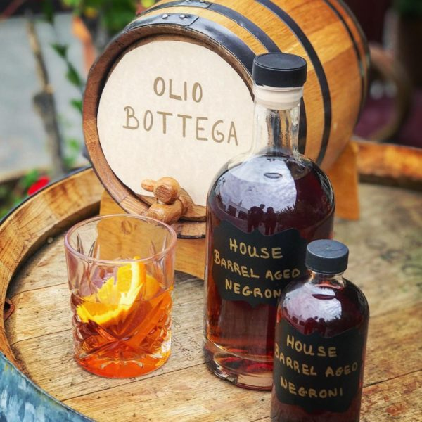 At Olio Bottega, we barrel age this popular Italian cocktail— made with gin, vermouth rosso, and Campari— in our oak barrels for 3 months, bringing out a more complex, smoky flavor.